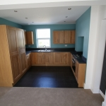 B&Q Kitchen Fitting Turquoise Walls & Solid Oak Fronts