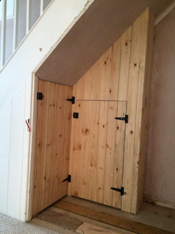 Bespoke joinery, wooden pine understairs storage Exeter