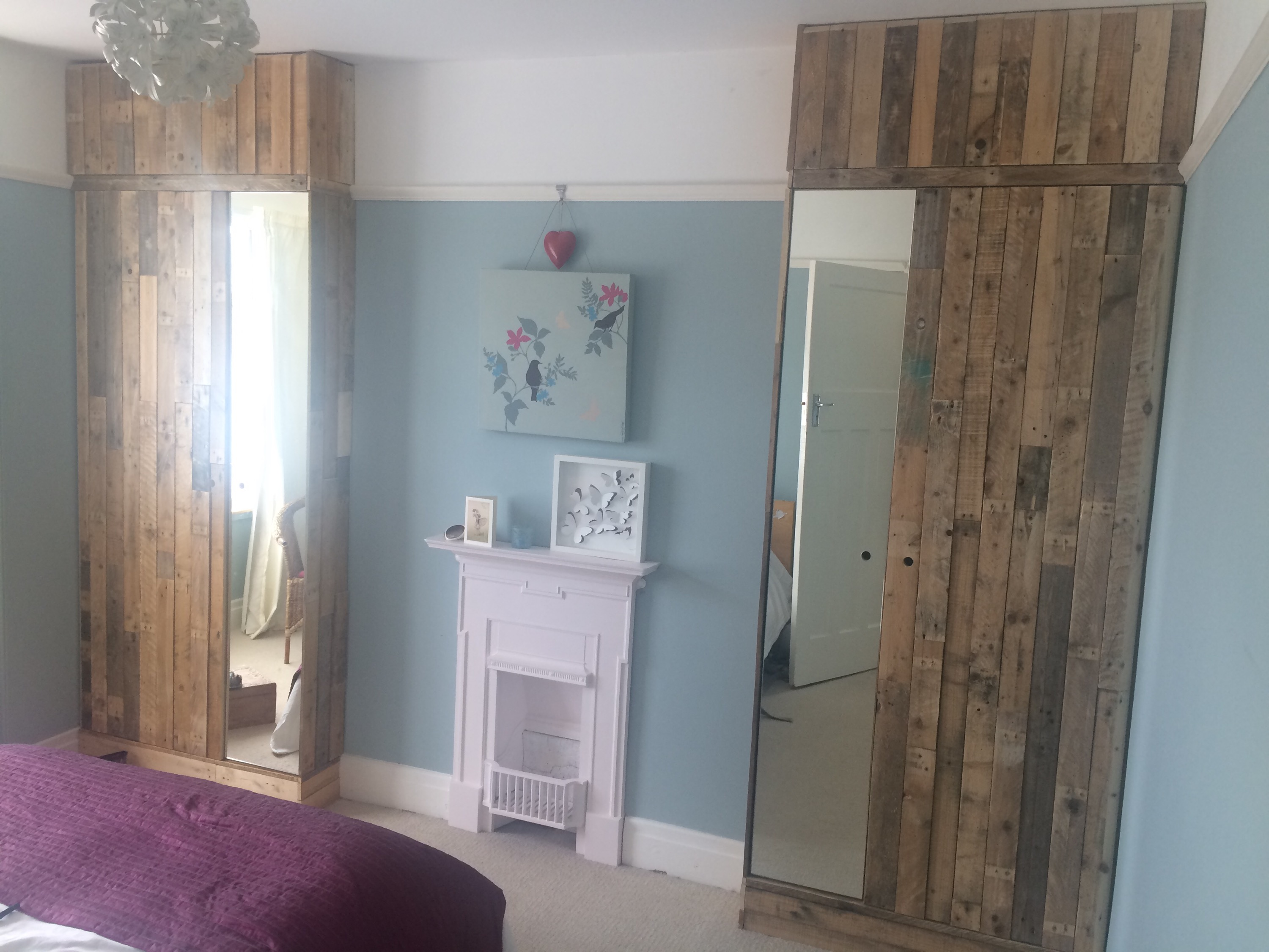 Bespoke wooden pallet and mirrored bedroom cupboards